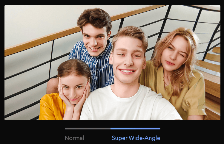 four youngsters taking selfie while sitting stairs